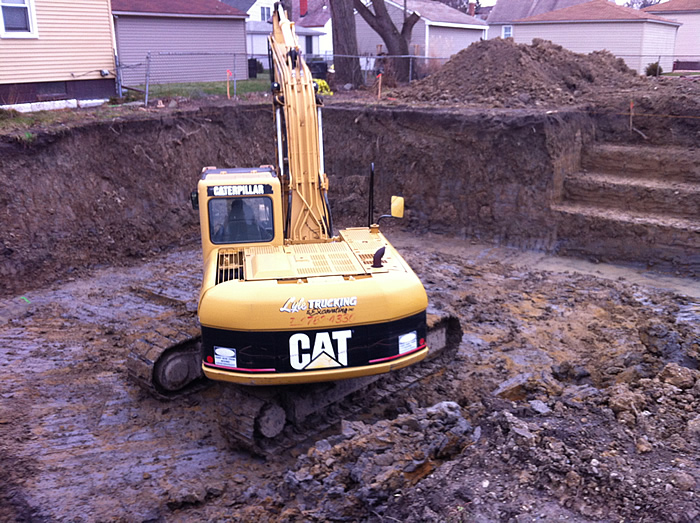 Installing water, sewer and sump lines